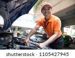 auto mechanic in garage  car... | Shutterstock . vector #1105427945