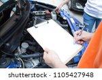 auto mechanic in garage  car... | Shutterstock . vector #1105427948
