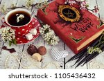 red cup of flower tea with... | Shutterstock . vector #1105436432