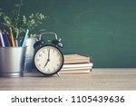 alarm clock on wooden table on... | Shutterstock . vector #1105439636