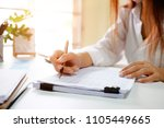 close up audit woman calculate... | Shutterstock . vector #1105449665