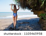 sporty girl in bikini with surf ... | Shutterstock . vector #1105465958