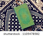 Small photo of The Quran, the central religious text of Islam