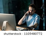 employee speaking on phone... | Shutterstock . vector #1105480772