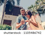 couple using their phone while... | Shutterstock . vector #1105486742