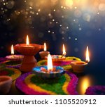 diya lamps lit on colorful...   Shutterstock . vector #1105520912