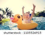happy boy and a yellow duck... | Shutterstock . vector #1105526915