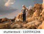 young woman standing on the top ... | Shutterstock . vector #1105541246