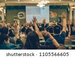 rear view of audience showing... | Shutterstock . vector #1105566605