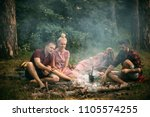 two couples having picnic in... | Shutterstock . vector #1105574255