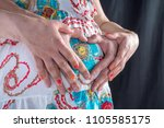 pregnant woman and her husband... | Shutterstock . vector #1105585175