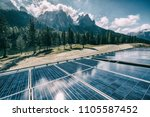 solar roof panels on the house... | Shutterstock . vector #1105587452