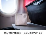Small photo of Airsick nauseous person in the air sickness vomit bag prepared to vomit