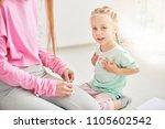 baby dirl and her mother...   Shutterstock . vector #1105602542
