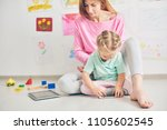 young mother and her cute baby... | Shutterstock . vector #1105602545