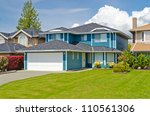 luxury house at sunny day in... | Shutterstock . vector #110561306