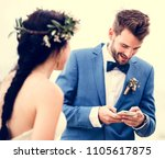 groom checking his phone at... | Shutterstock . vector #1105617875