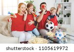 a family of fans watching a... | Shutterstock . vector #1105619972