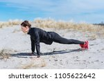 full length side view of a fit... | Shutterstock . vector #1105622642