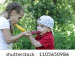 pretty little girl feeding a... | Shutterstock . vector #1105650986