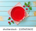 empty red plate with colored... | Shutterstock . vector #1105653632