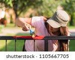pretty girl is painting metal... | Shutterstock . vector #1105667705