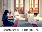 muslims reading from the quran | Shutterstock . vector #1105683878