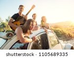 group of happy people in a car... | Shutterstock . vector #1105689335