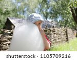 funny little boy eating cotton... | Shutterstock . vector #1105709216