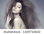 young beautiful woman with long ... | Shutterstock . vector #1105710632