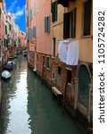 Small photo of Characteristic glimpse with the navigable canal in the island of Venice with the boats the clothes of the laundry