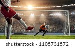 soccer player is trying to... | Shutterstock . vector #1105731572