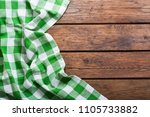 green tablecloth on old wooden... | Shutterstock . vector #1105733882