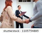 real estate agent near door... | Shutterstock . vector #1105754885