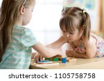 kids playing with colorful toys.... | Shutterstock . vector #1105758758