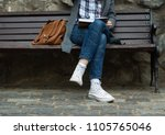 trendy young woman reading... | Shutterstock . vector #1105765046