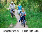 active senior couple with kids... | Shutterstock . vector #1105785038