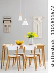 white chairs at wooden table...   Shutterstock . vector #1105811672