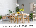 white lamps above wooden table... | Shutterstock . vector #1105811678