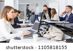 hardworking coworkers work on... | Shutterstock . vector #1105818155