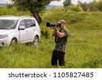a bird watcher and bird... | Shutterstock . vector #1105827485