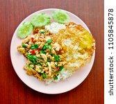 stir fries chicken breast with... | Shutterstock . vector #1105845878