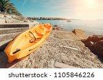 bright orange kayak is on the... | Shutterstock . vector #1105846226