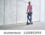 happy man riding kick scooter   Shutterstock . vector #1105852955