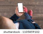 man holding smartphone. mobile... | Shutterstock . vector #1105859102