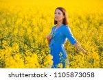 pretty girl holding yellow...   Shutterstock . vector #1105873058