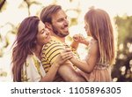 happy family at nature.... | Shutterstock . vector #1105896305