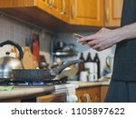 a young man in the kitchen... | Shutterstock . vector #1105897622