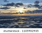 sunset on the beach with... | Shutterstock . vector #1105902935