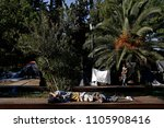 refugees and migrants rest in... | Shutterstock . vector #1105908416